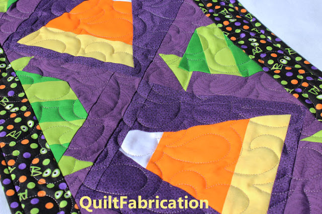 closeup of Halloween Candy table runner by QuiltFabrication