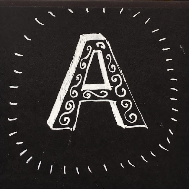 Letter A with decorative elements. Drawn with white ink on black paper. By Boriana Giormova
