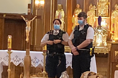 Police invading a church