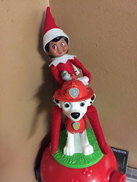 An elf doll riding a Dalmatian dog