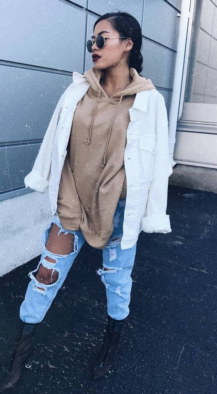 winter street style / white jacket + nude sweatshirt + distressed jeans + boots