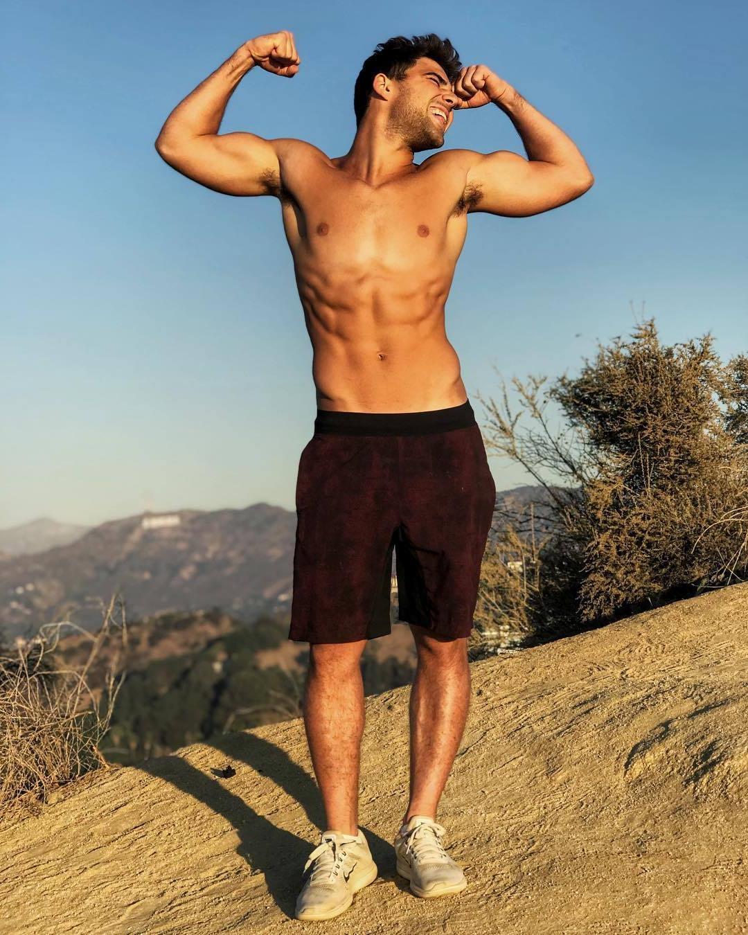 adorable-shirtless-slim-fit-gay-twink-hairy-armpits-biceps-flex-yawning
