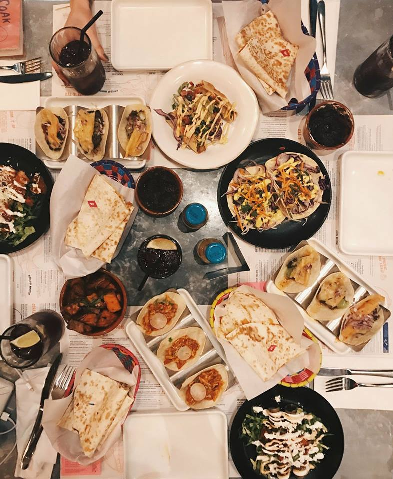 this is a picture of a wahaca feast including tacos