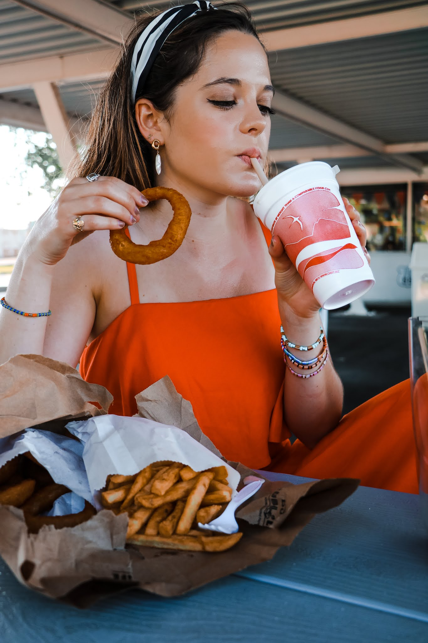 Nyc style influencer, Kathleen Harper eating fast food during a photo shoot.