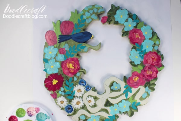 painted wooden cut out wreath with acrylic craft paint