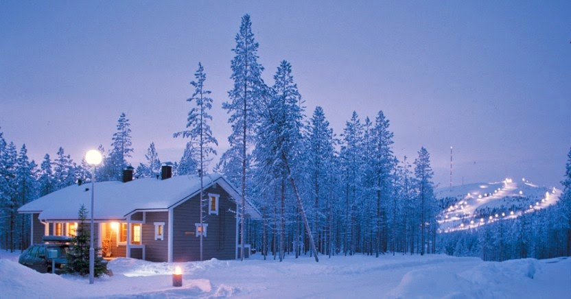 Finland cabin covered in snow