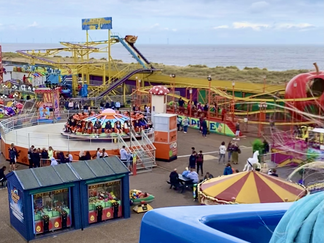 A view over some of Great Yarmouth Pleasure Beach and the sea taken from on the monorail ride