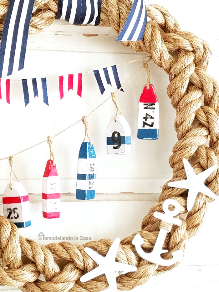 braided rope wreath with buoys and flags garlands diy