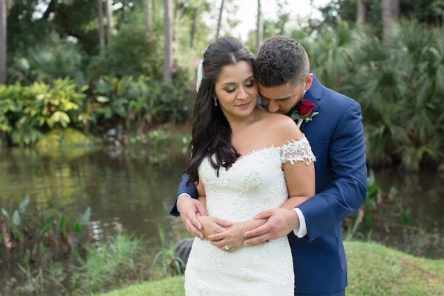 groom kisses bride shoulder