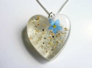 Cremated ashes and forget me not flower resin heart pendant