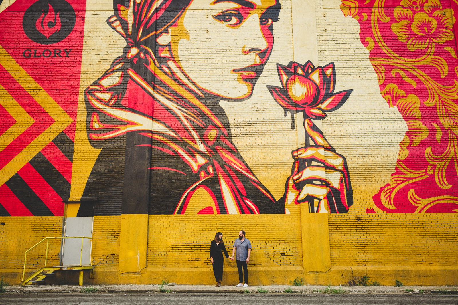 Jersey City colorful engagement photos with Shepard Fairey mural | blog.cassiecastellaw.com