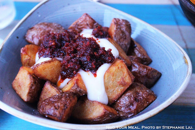 Xiringuito Fried Potatoes in Spicy Tomato Sauce at Xiringuito Escribà in Barcelona