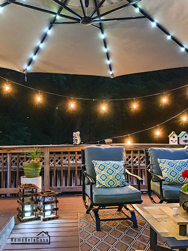 lighted outdooor umbrella and string lights on deck