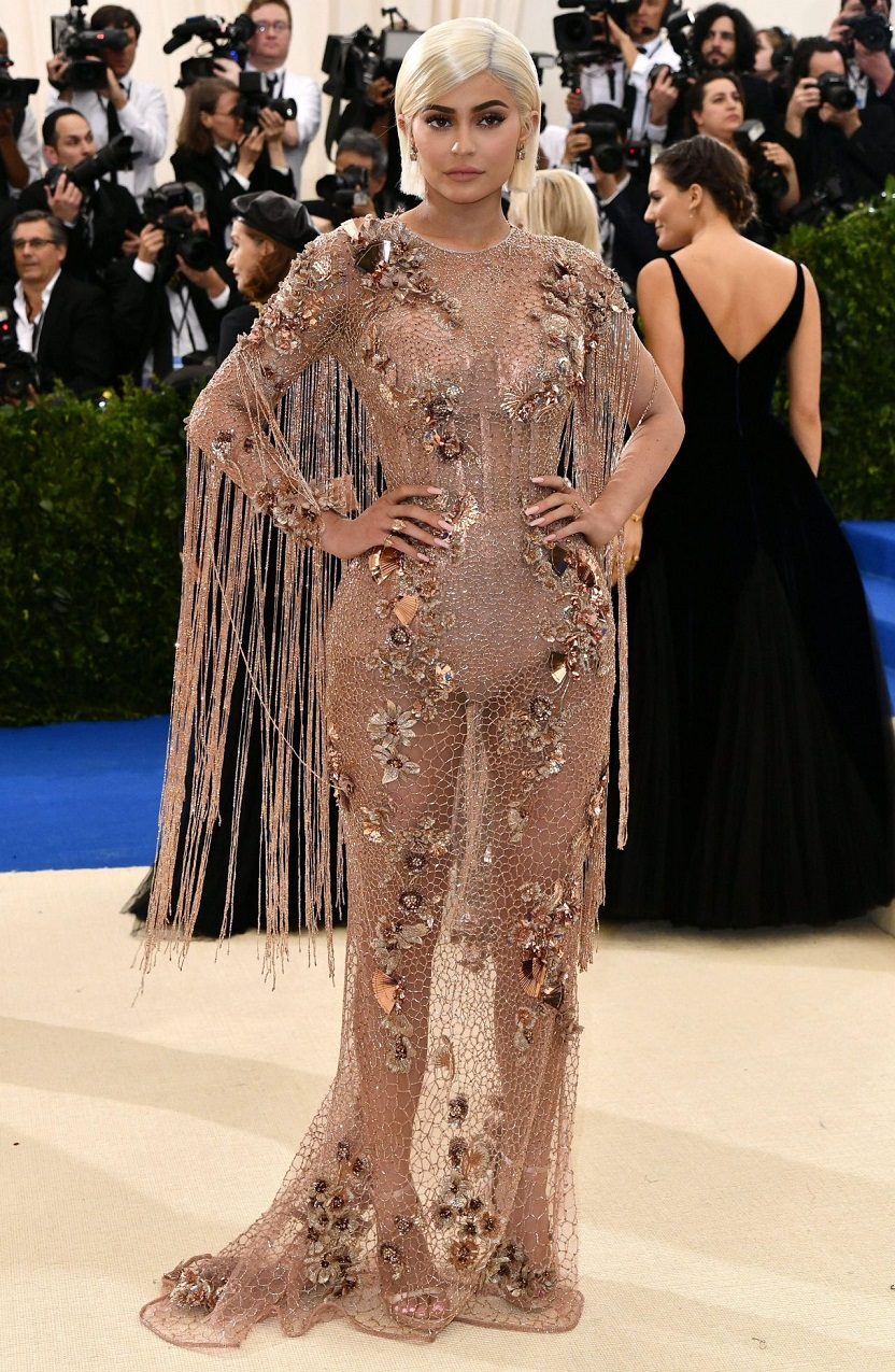 Kylie Jenner arrived for the 2017 Met Gala in a Versace gown dripping with sea shell and pebble embellishments