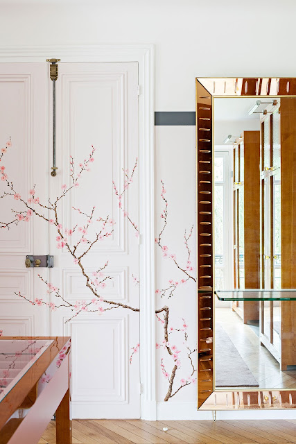 Breathtaking handpainted cherry blossoms in modern interior design in Chateau de Saint Cloud by Tristan Auer