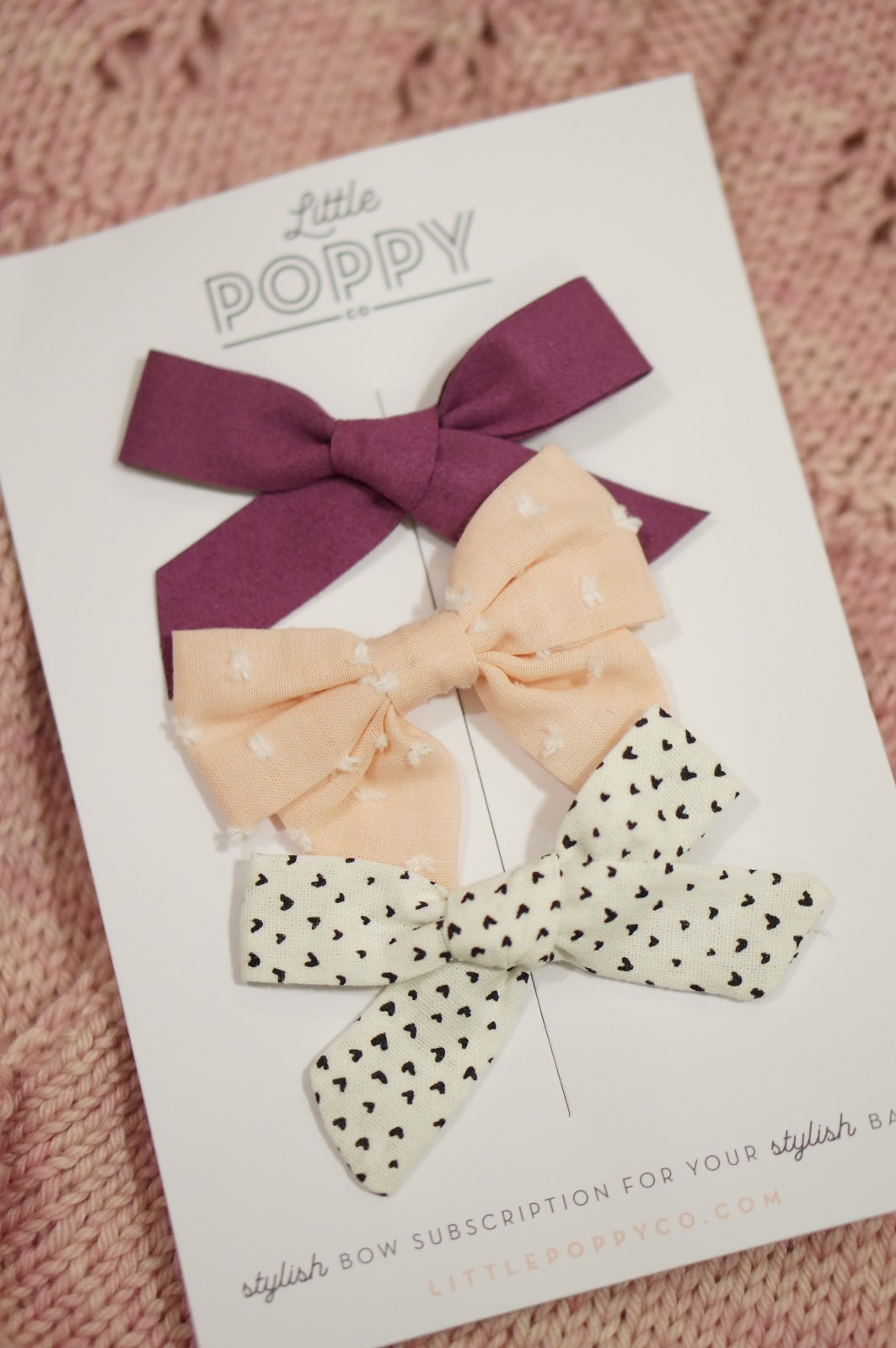 Popular North Carolina style blogger Rebecca Lately shares Little Poppy Co bows for February. Read more here!