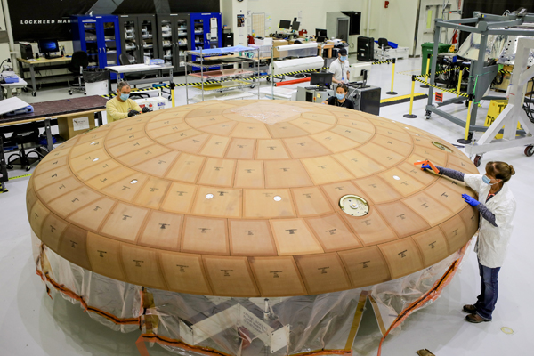 At NASA's Kennedy Space Center in Florida, technicians finish applying more than 180 blocks of ablative material to the heat shield that will be attached to the Orion spacecraft for the Artemis 2 mission.