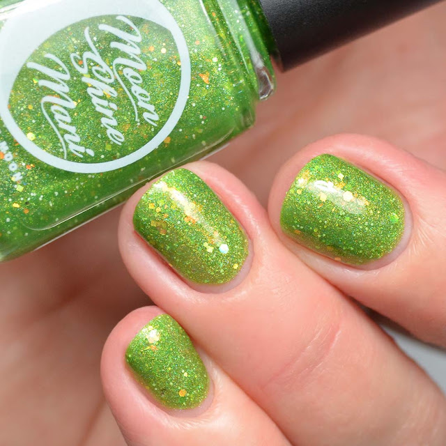 green nail polish with iridescent glitter swatch