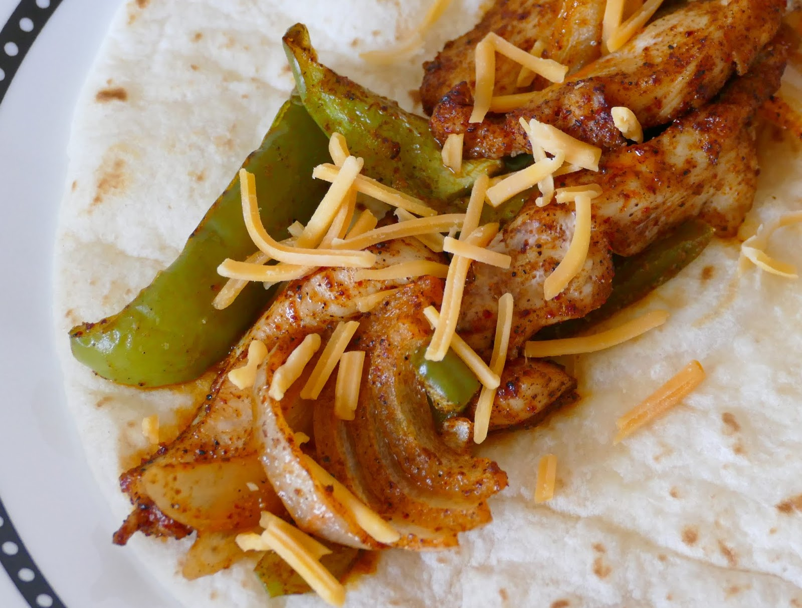 Dinner is on the table in 30 minutes with this easy Mexican recipe! All the flavors of a traditional fajita, baked in the oven, served on a flour tortilla with your favorite toppings! Great with chicken, steak or shrimp!