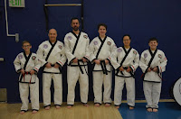 A group of black belts doing Taekwondo classes at the CTI