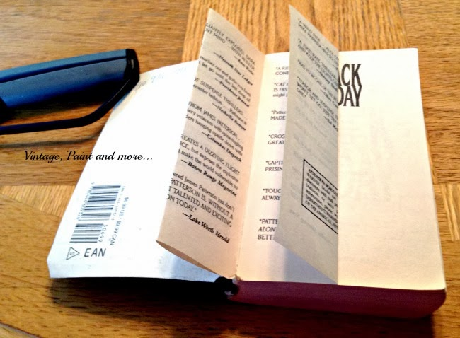 Book Page Note Holder - Image of paper back book with several folded pages