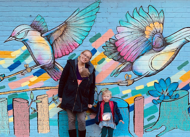 Posing against wall art just off Brick Lane