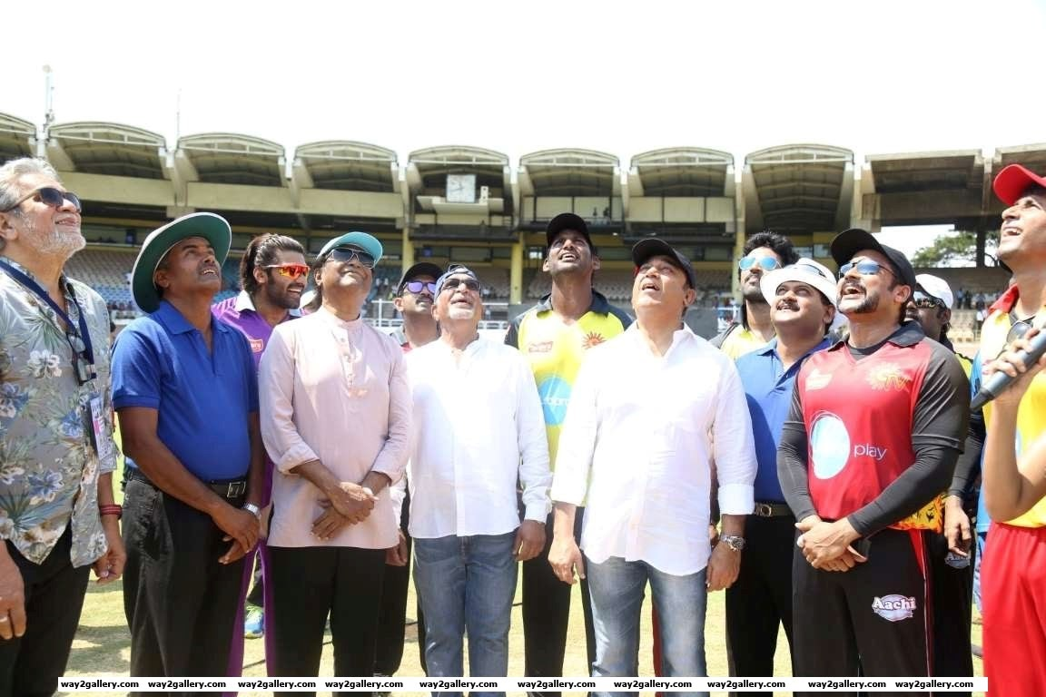 Rajinikanth Nassar Vishal Kamal Haasan and Suriya watch the coin during the toss for the first match of the Natchathira cricket tournament