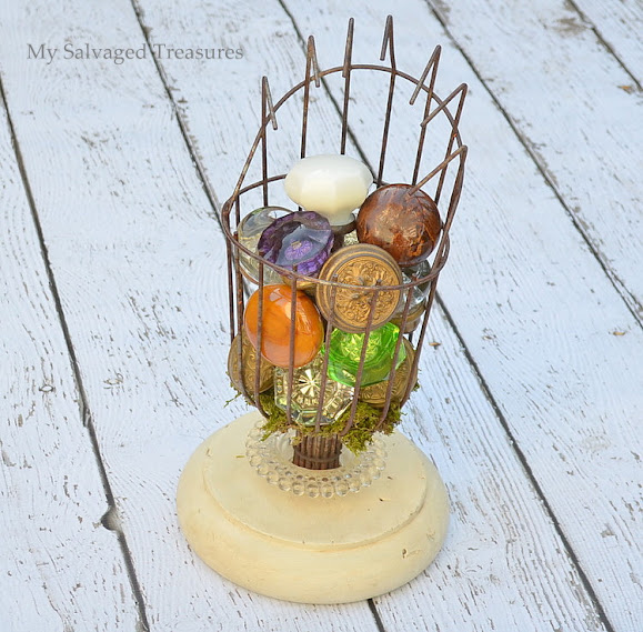 display vintage doorknobs in an upcycled fruit picking basket