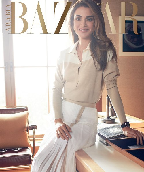 Queen Rania wore a Layeur Barbara slouch collar tie top and wide-leg trousers, and a cream jumper and skirt by Hugo Boss