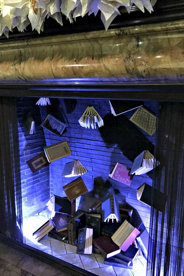 Suspended books hanging in fireplace and book art mantel decor