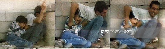 "The last moments of Mohamed El-Dorra which his father tried to protect him ""AFP"""