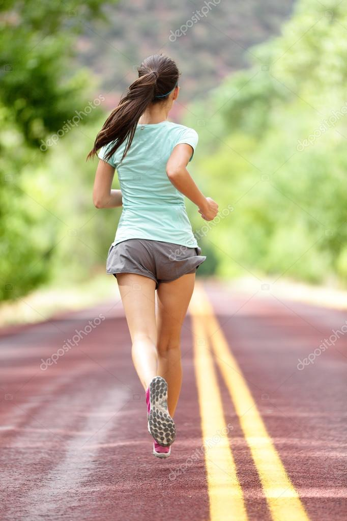 Running away on rural road is a form of athlete training with proper short and running shoes.