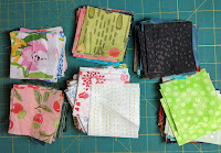 """2.5"""" squares cut from remnant of cotton fabrics in the scrap bag. These can be used for many different quilts including Trip Around the World"""