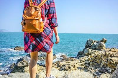 Shore walking woman