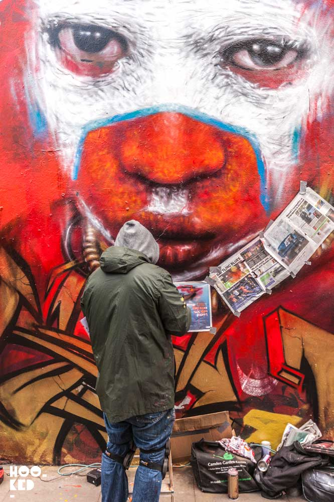 English Street Artist Dale Grimshaw at work on a mural