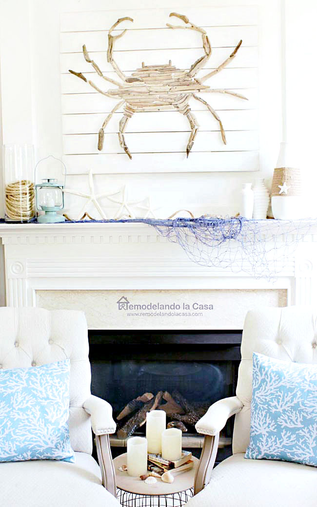 starfish, rope, blue fishnet, white vases, blue lamp on mantel