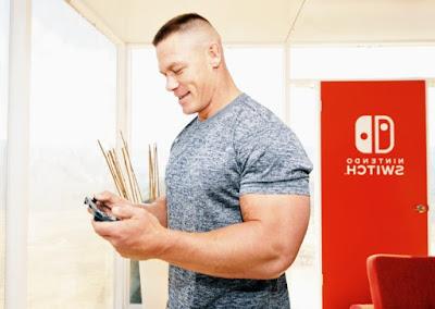 John Cena holding a Nintendo switch game