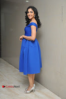 Actress Ritu Varma Pos in Blue Short Dress at Keshava Telugu Movie Audio Launch .COM 0073.jpg
