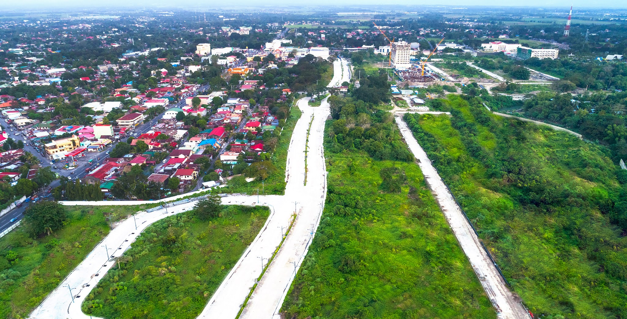 Ongoing developments inside the 34-hectare The Upper East township in Bacolod City where the company plans to build more office towers, malls, and residential towers in the next 5 years.
