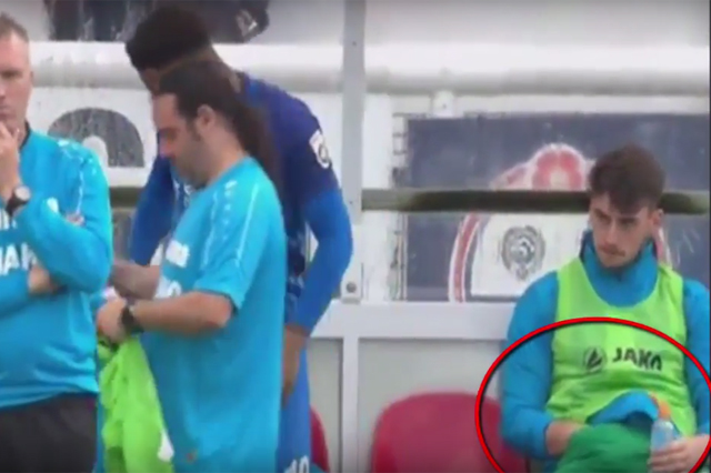 Leyton Orient goalkeeper Sam Sargeant captured scratching his balls on the bench