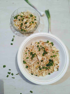 Serving Chicken fried rice recipe with  green scallions garnished