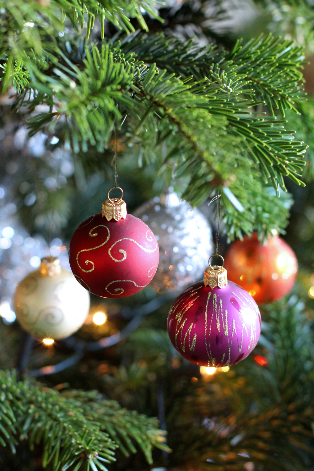 Multi-coloured baubles on our real Christmas tree - UK style blog