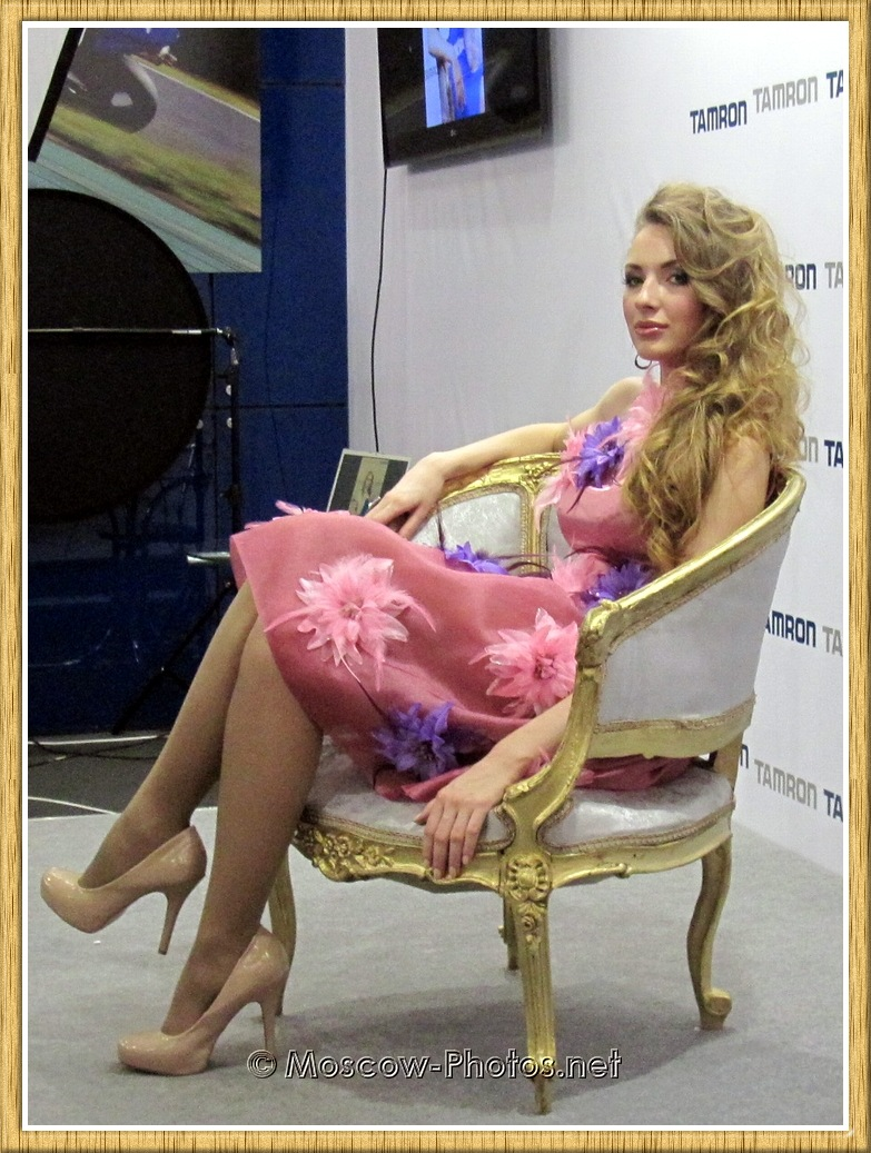 Moscow model in red dress at Photoforum 2011