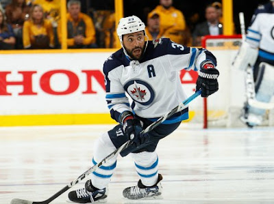 Dustin Byfuglien playing Ice hockey for his team