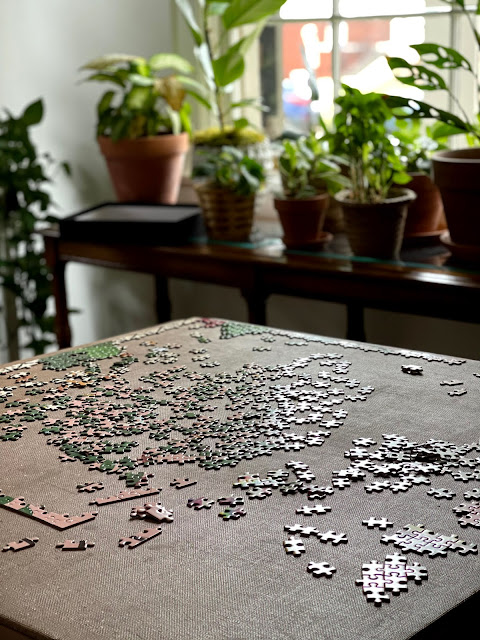 puzzle pieces on a folding table