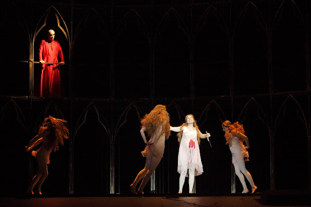 Gounod: Faust - Andreass Bauer (Mephistopheles), Marina Rebeka (Marguerite) & dancers (Photo: Agnese Zeltina (c) Latvian National Opera and Ballet)