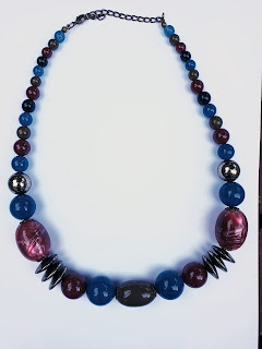 Large bead necklace in pink, blue and gold 1990s