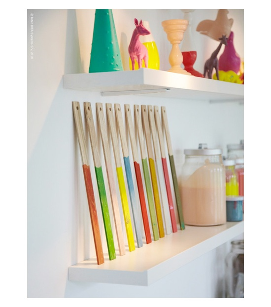 These color dipped paint sticks are great decorative pieces for a craft room.