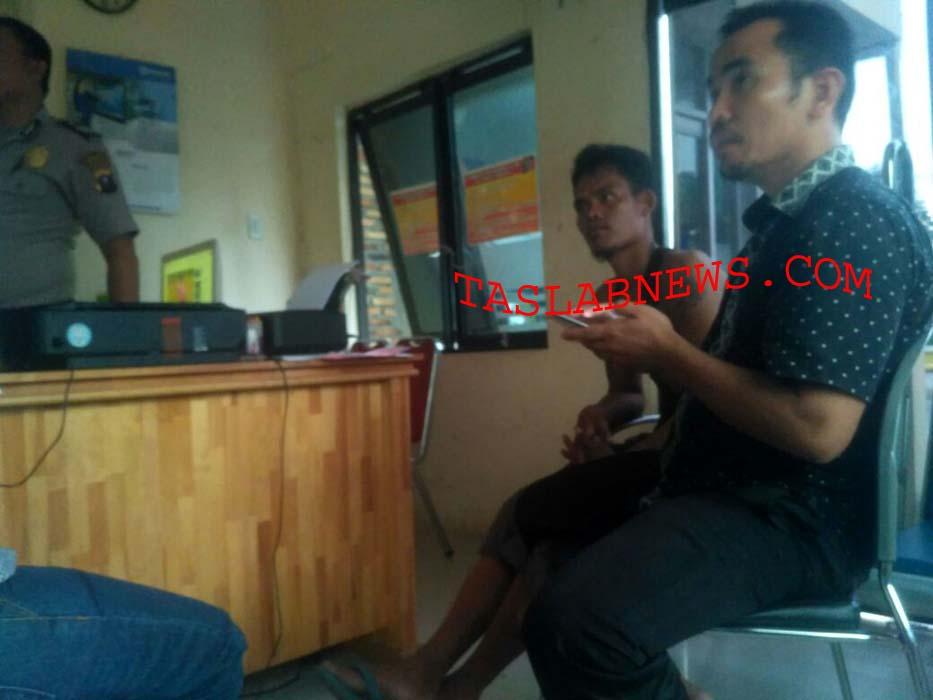 Rano Pasi supir taksi online yang dirampok saat membuat pengaduan di kantor polisi