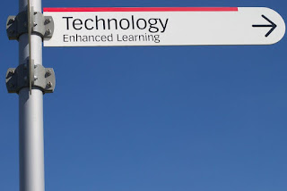 "picture of sign that says ""technology enhanced learning"" with an arrow pointing in a direction."